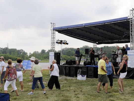 Attendees of the eighth annual Marblehead Rocks! dance to the sounds of Toledo's own The Homewreckers at Marblehead Estates & Yacht Club on Saturday evening.