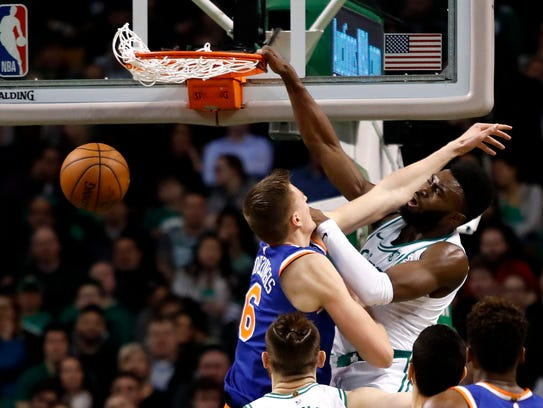 Boston Celtics guard Jaylen Brown (7) dunks on New
