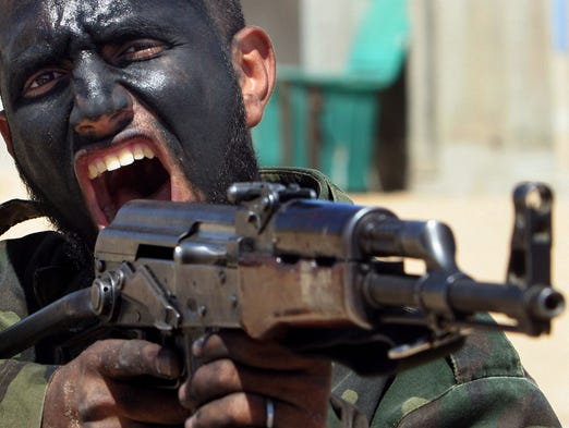 A member of the Hamas security force demonstrates skills with an AK-47 rifle during a graduation ceremony at a training area on March 25, 2007, at the Rafah refugee camp in the southern Gaza Strip. The AK-47 has been favored by guerrillas, terrorists and the soldiers of many armies. An estimated 100 million guns are in use around the world.