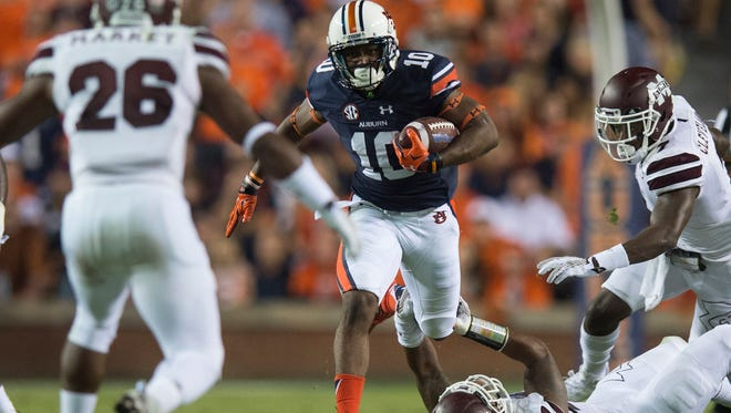 Auburn wide receiver Stanton Truitt (10) runs over Mississippi State linebacker Beniquez Brown (42) during the NCAA football game between Auburn and Mississippi State on Saturday, Sept. 26, 2015, at Jordan-Hare Stadium in Auburn, Ala.