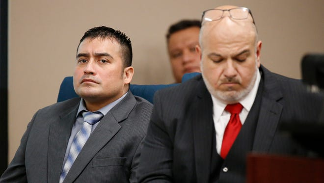 Hisaias Justo Lopez, left, sits with his lawyer, Marcelo Rivera, during the opening day of testimony in his retrial, which began Monday morning.