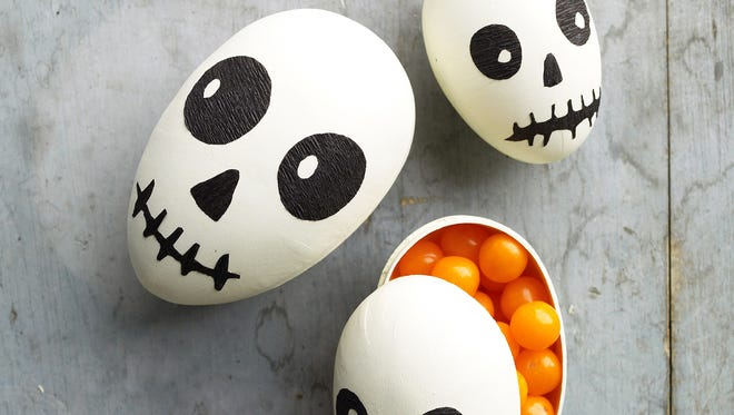 Eggs decorated in a Halloween skull-theme. The blending of holiday traditions _ think Hanukkah bush _ now kicks off with Halloween in a variety of ways. The Easter tradition of decorating eggs in pretty pastels has morphed into spooky or playful takes for Halloween.