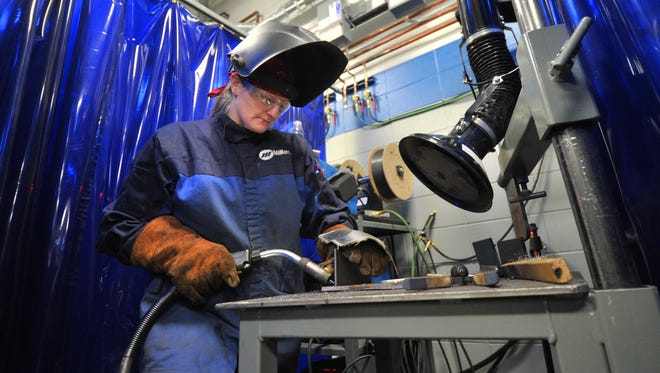 Student Debi White, 26, of Wausau, prepares to join two pieces of metal during a welding class at Northcentral Technical College in Wausau.
