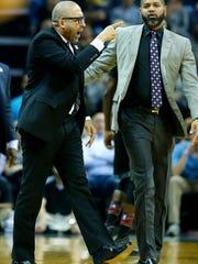 Memphis Grizzlies head coach David Fizdale rushes the