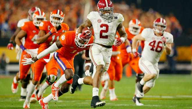 Derrick Henry, #2 of the Alabama Crimson Tide, runs for a 50-yard touchdown in the first quarter against Jayron Kearse #1 of the Clemson Tigers during the 2016 College Football Playoff National Championship Game at University of Phoenix Stadium on January 11, 2016.