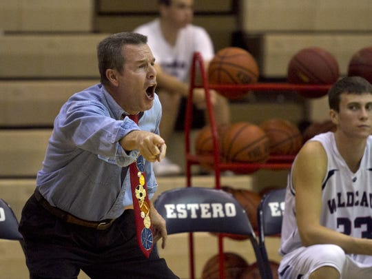 Coach Lee Peters instructs his players at Estero High School on Tuesday night against Ida Baker in Estero.