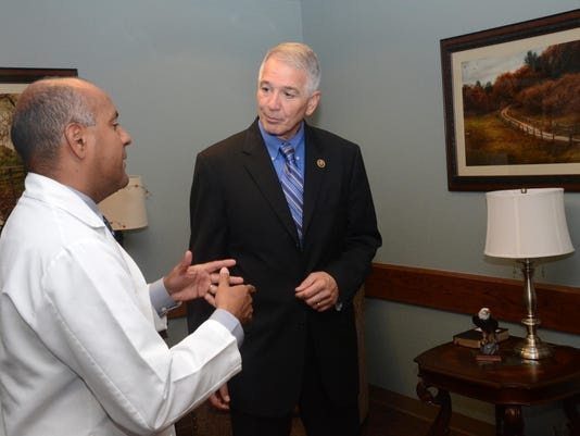 ANI Abraham Tours VA Dr. Jose' Rivera (left) tells U.S. Rep. Ralph Abraham about the serenity room located in the main hospital at the VA Medical Center in Pineville.-Melinda Martinez/The Town Talk