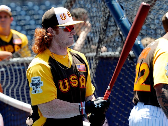 U.S Team's Clint Frazier, when his red locks were long, prepares to hit prior to the All-Star Futures baseball game against the Word team, Sunday, July 10, 2016, in San Diego.