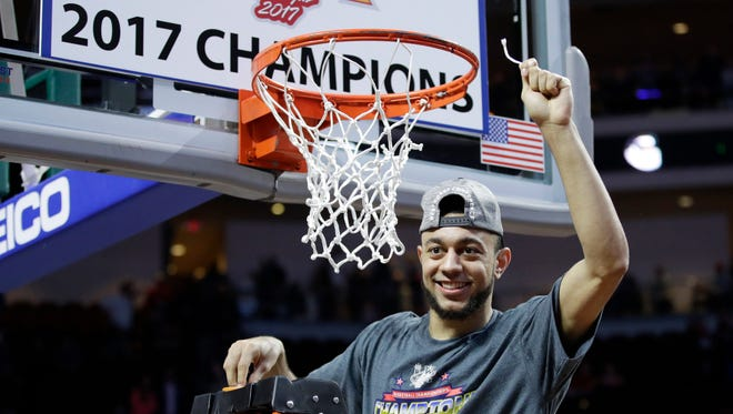 Gonzaga's Nigel Williams-Goss cuts down a piece of the net after the Bulldogs defeated Saint Mary's 74-56 in the West Coast Conference title game Tuesday in Las Vegas.