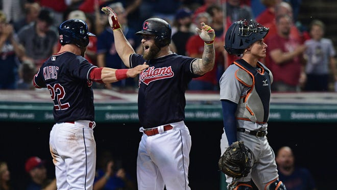 The Cleveland Indians' Mike Napoli, center, celebrates after hitting a two-run home run against the Detroit Tigers Sept. 16, 2016, in Cleveland.