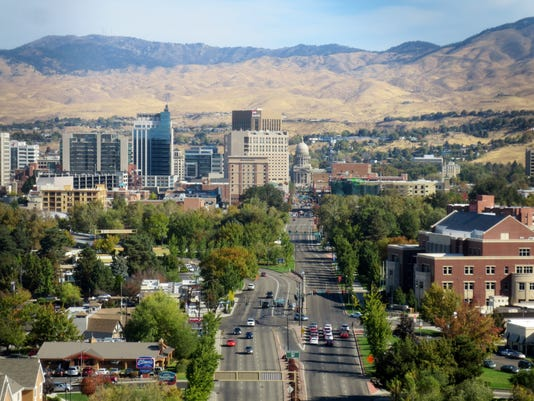 636123809064076705-1.-View-of-downtown-Boise-at-the-base-of-the-Rocky-Mountain-foothills.JPG