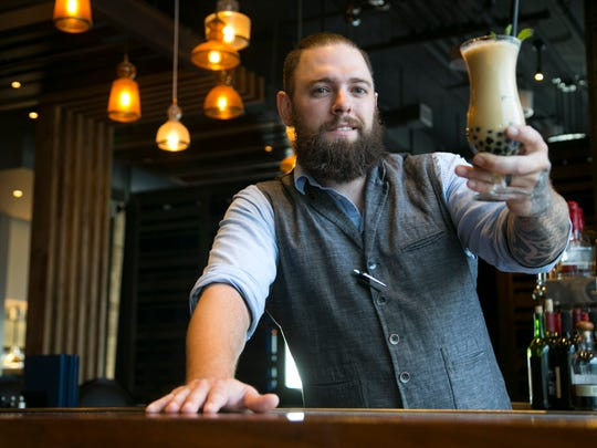 Head bartender Phil Clark of Blue Hound Kitchen and