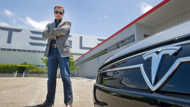 Elon Musk of Tesla with a new Model S  car outside the Tesla customer deliver area