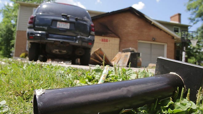 A firework launcher lies in the front yard of this Jackson Township duplex at 2803 Brighton Circle NW that burned late Tuesday evening. Fireworks casings were strewn all over the yard.