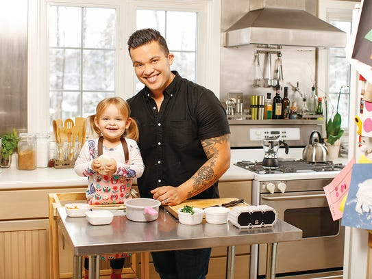 Steve Lara and his daughter cook together at home.