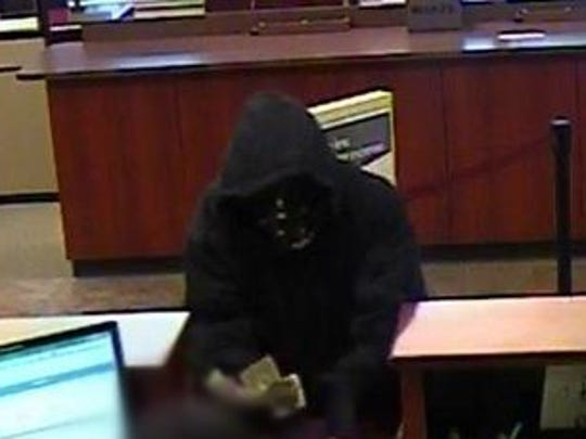 Surveillance footage from inside bank.