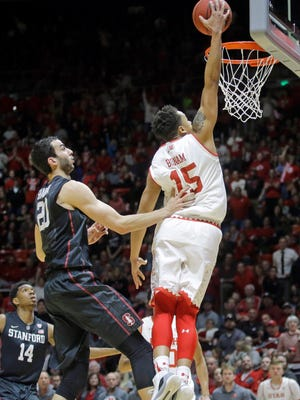 Utah guard Lorenzo Bonam (15) dunks on Stanford center Josh Sharma (20) during the second half in an NCAA college basketball game Saturday, March 4, 2017, in Salt Lake City. Utah won 67-59.