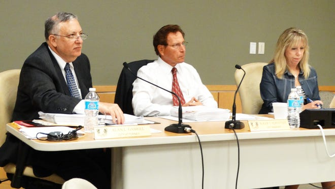 City Attorney Alan Gabriel and City Manager Roger Hernstadt field inquiries about the status of The Esplanade legal discussions.