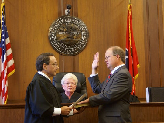 General Sessions Division I Judge James Hunter administers the oath of office to newly elected Sumner County Circuit Court Judge Joe Thompson.