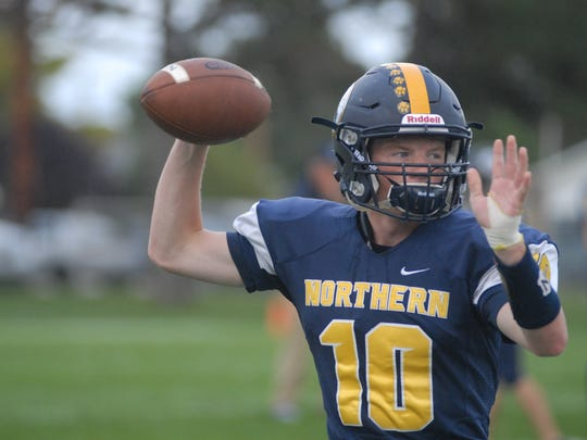 Port Huron Northern quarterback Billy Fealko warms up before the Huskies game against East Detroit on Sept. 23, 2016.