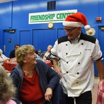 Last holiday season Ron Traudt, right, executive director of the City of Beacon Housing Authority, shares a moment during a dinner event with Nancy Hoffman, left, a resident of Forrestal Heights, one of the apartment complexes the Housing Authority manages. Gift cards funded by Holiday Helping Hand were given out at the end of the dinner.