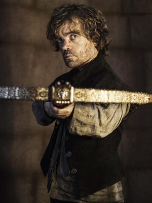 Tyrion Lannister (Peter Dinklage) aims a crossbow on HBO's 'Game of Thrones.'