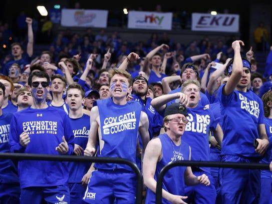 Covington Catholic fans cheer their team against Scott