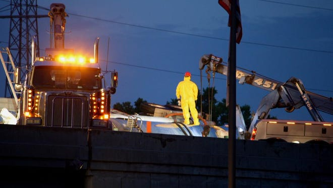 Crews work to clear a wrecked tanker truck from I-75 Friday morning. The road was expected to be closed through 9 a.m.