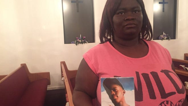 La'Shelle Bigsby holds a picture of her son Ronquez, who was killed in the James Cayce Homes in East Nashville in 2010 when he was 14.