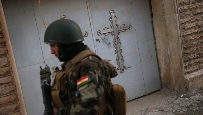 A Christian militiaman patrols Telskuf, northern Iraq, on Nov. 4, 2015.