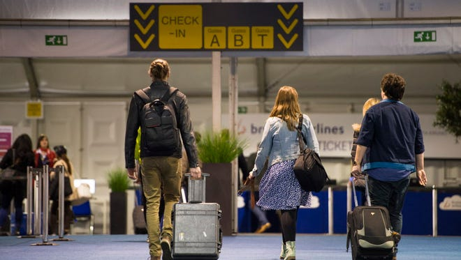 Passengers arrive at the temporarily check in terminal at Brussels Airport, in Zaventem, Belgium on April 4, 2016. Under extra security controls Brussels airport reopened last Sunday.