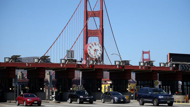 Cars pass through the Golden Gate Bridge toll plaza on Sept. 19, 2012, in San Francisco.