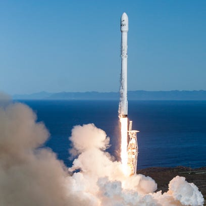 A SpaceX Falcon 9 rocket blasts off from Vandenberg