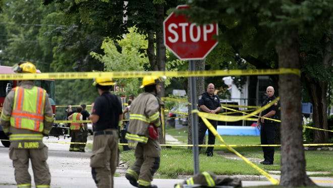Police tape marks off the scene of a police shooting Aug. 19 in New London.