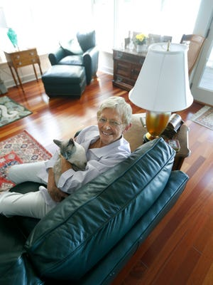 Barbara Iglewski, professor emeritus and former chairwoman of the Department of Microbiology and Immunology at the University of Rochester, with her Diamese cat Katherine Hepburn at her home in Canandaigua. She will be inducted into the National Women's Hall of Fame this weekend.