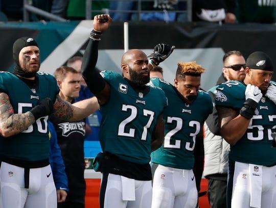 Philadelphia Eagles' Chris Long, from left, Malcolm