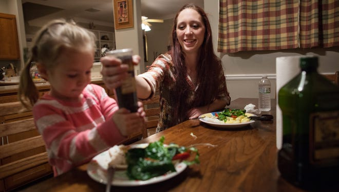 Maggie Barcellano, who lives with her father, enrolled in the food stamps program to help save up for paramedic training while she works as a home health aide and raises her daughter.