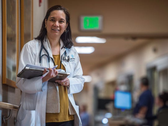 A doctor in the Reid Health critical care unit walks