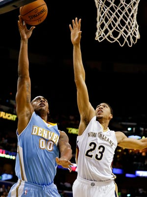 Anthony Davis (23) had a monster game to lead the Pelicans to an overtime victory against the Nuggets.