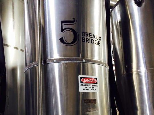A batch of Rikenjaks Old Hardhead is fermenting in Tank No. 5 — the Breaux Bridge tank — at Bayou Teche Brewing.