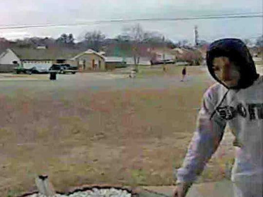 Video surveillance shows a porch bandit stealing Christmas gifts from a front door in Clarksville.