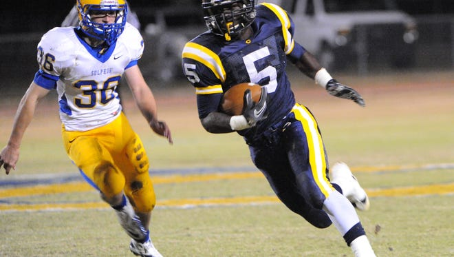 (5)  Alex Johnson carries for Carencro as The Carencro Bears host the Sulphur High Tornadoes on November 4. 2011. Chris Daigle Special to the Advertiser