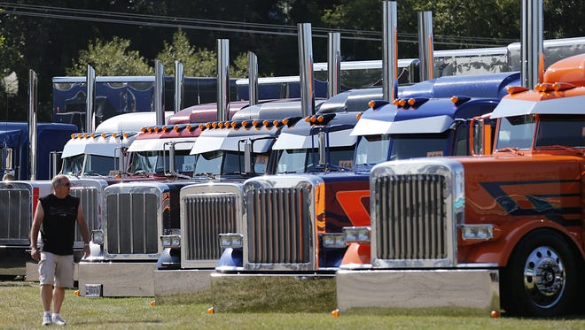 Kelly Vande Zande of Brandon looks at a line of trucks Aug. 15, 2015, at the Waupun Truck-n-Show. More than 100 exhibitors attended the 26th annual show that included a fish fry, truck judging and parade.
