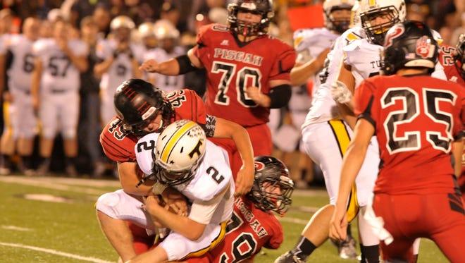 The Pisgah defense tackles Tuscola quarterback Parker Allen on Friday in Canton.