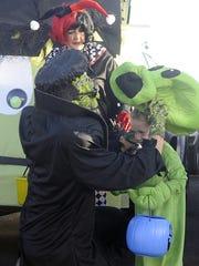 Dressed as Frankenstein, Jason Borsini puts a mask