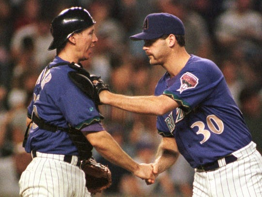 Arizona Diamondbacks catcher Damian Miller, left, and Diamondbacks closer Gregg Olson congratulate each other after getting Florida Marlins' Cliff Floyd to ground out in the ninth inning to end the game Tuesday, June 15, 1999 in Phoenix. The Diamondbacks won 4-3. (AP Photo/Mike Fiala)