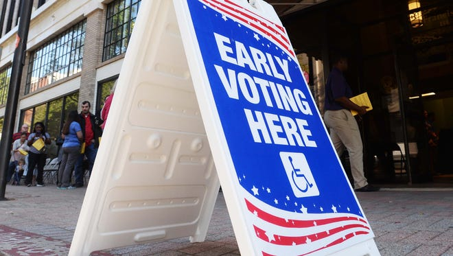Voters form a long line as they wait their turn to vote early Friday morning.