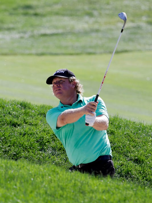 William McGirt hits out of a bunker on the first playoff hole during the final round of the Memorial golf tournament, Sunday, June 5, 2016, in Dublin, Ohio. (AP Photo/Darron Cummings)