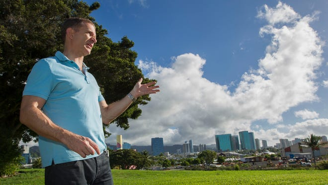 In this Dec. 24, 2013 photo, Robert Perkinson, an associate professor at the University of Hawaii at Manoa, talks about the possible location in the Kakaako district of Honolulu to be considered for the Barack Obama Presidential Library. The plot of land can be seen to the far right.