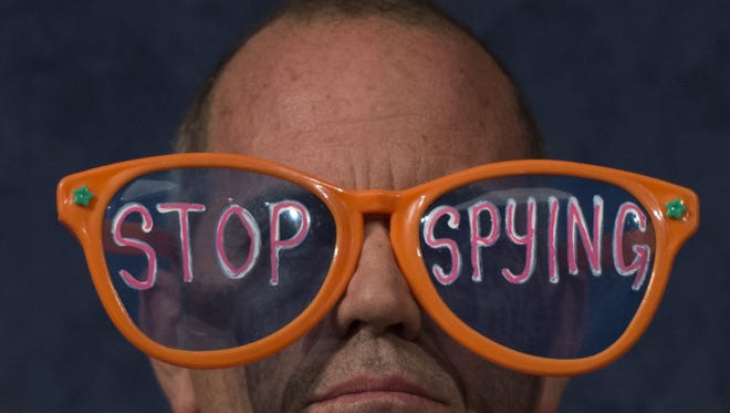 A Code Pink demonstrator attends a congressional hearing with Director of National Intelligence James Clapper on Oct. 29.